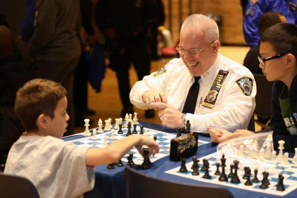 Police Chief Brian McCarthy getting schooled in chess