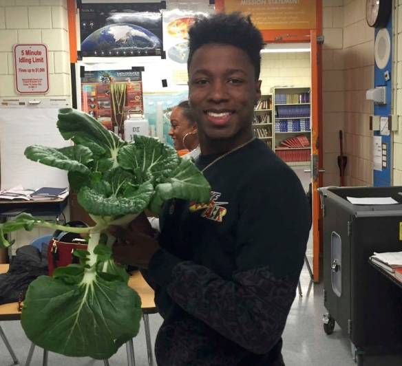 Student with vegetable