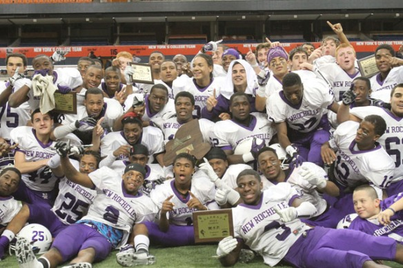 New Rochelle players celebrate their 34-6 victory over Orchard Park to win the New York state Class AA football championship at the Carrier Dome in Syracuse Nov. 24, 2012. ( Frank Becerra Jr / The Journal News )