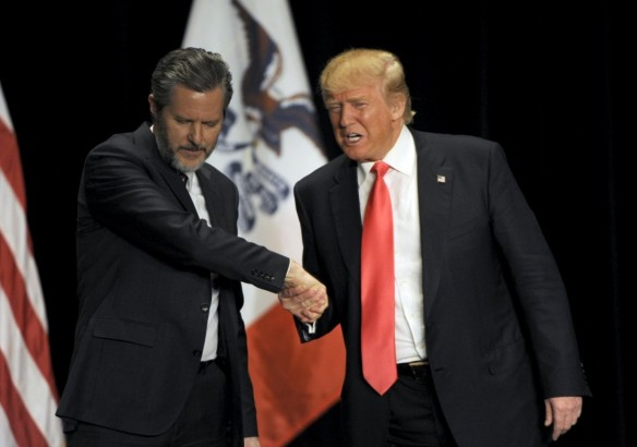 Republican presidential candidate Donald Trump (R) shakes hands with co-headliner Jerry Falwell Jr., leader of Liberty University in Virginia, at a campaign event in Iowa. (Reuters)